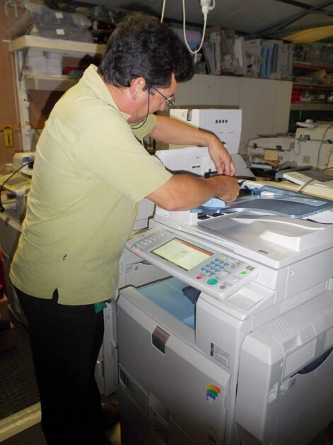 Technician Fixing a Photocopier